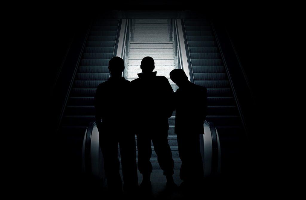 group of teens in dark